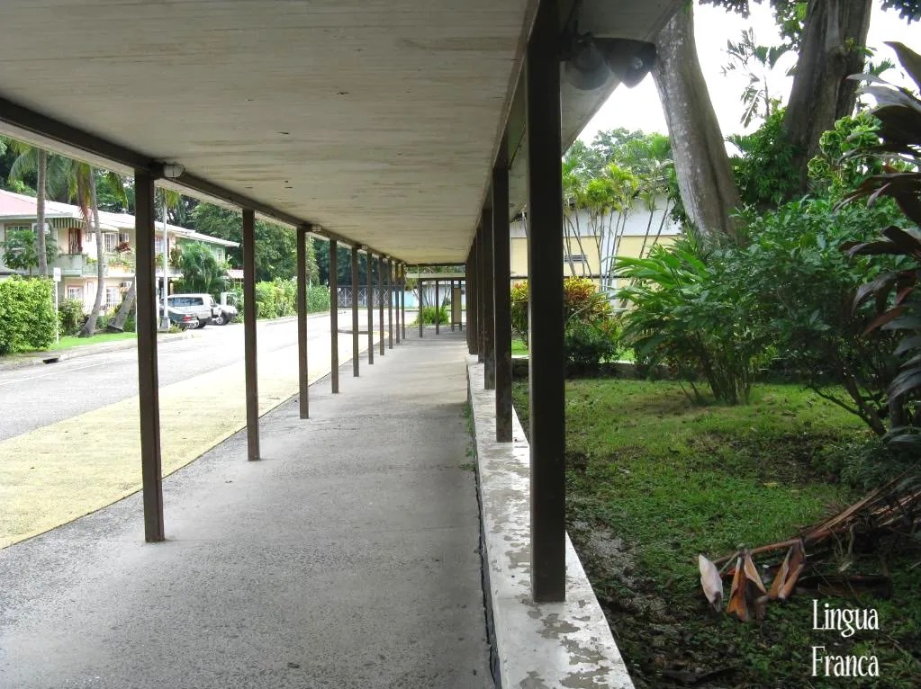 Perspective to the sheltered corridor leading to the entrance of the main building of the Canal Zone College.  (Credit:  Omar Upegui R.)