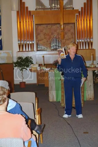 Rev. Hubbard holds Deloria book