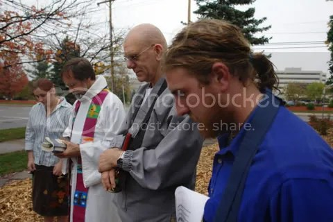 Two pastors lead the prayers - one a Zen Buddhist and the other Lutheran