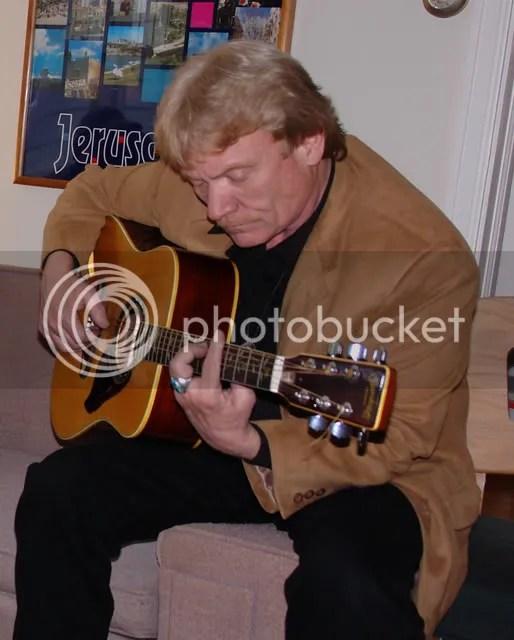 Rev. Hubbard on guitar