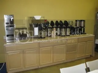 Heres our new coffee bar, for our use and for training customers.  The brewer is Fetcos latest eco-friendly model, which we now distribute.  Espresso station is on the other side of the room, out of sight in this picture.