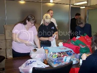 Angels, Tracy, KT, Daniel Tony, Gail and Jewell sorting candy & stockings. Yes all those boxes are ready to go!