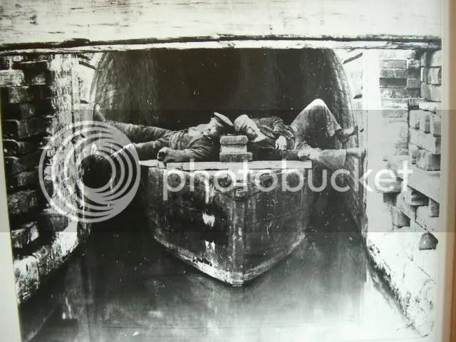 Legging through the Butterley Tunnel on the Erewash Canal, Derbyshire, 1895.