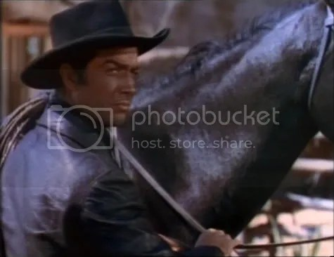Robert Taylor as Billy the Kid.