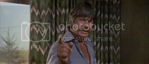 Charles Bronson - clearly not happy with the choice of curtains in this scene
