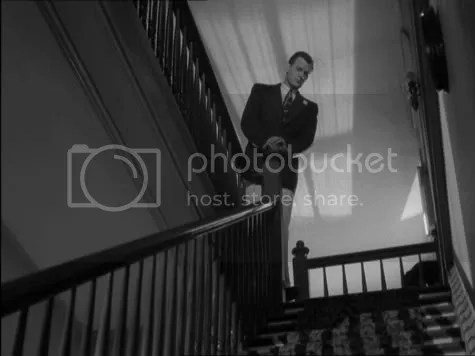 Uncle Charlie (Joseph Cotten) literally looking down on the world.