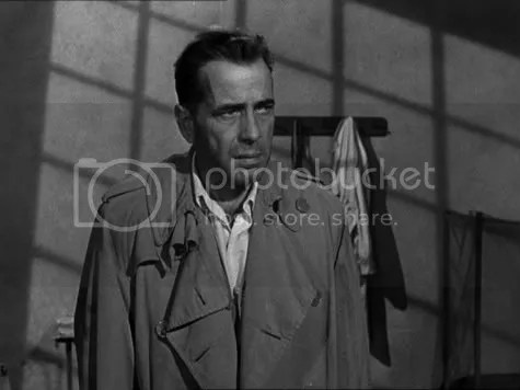 Humphrey Bogart is snared in a shadowy net.