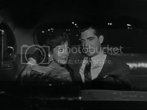 Moralising in the back of a cab - Ida Lupino and Dana Andrews in While the City Sleeps.