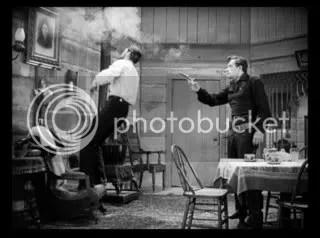 Betraying a friend - Bob Ford (John Ireland) shoots Jesse James (Reed Hadley).