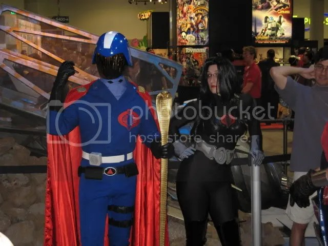 Cobra Commander performing a scene from Hamlet, while the Baroness looks on in boredom.