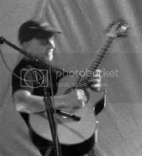 Phil Keaggy moves so fast that its almost impossible to catch him on digital imagery.  That and the lighting was poor.