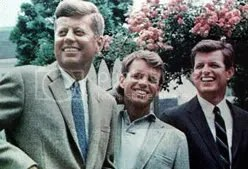 President John F. Kennedy (with brothers Robert F Kennedy and Edward M Kennedy)