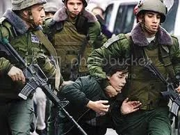 palestinian children photo: IDF rough up Palestinian boy hold him by the head PalChildrenIDF-heldbyhead.jpg