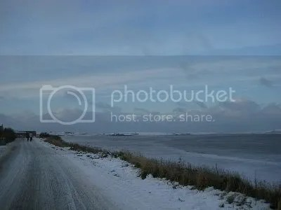 Another Orkney winter road and frozen Loch