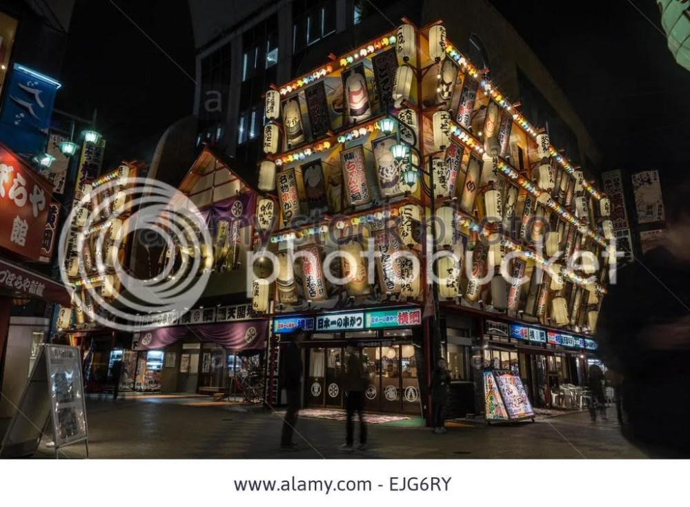 photo night-view-of-a-suno-themed-restaurant-in-the-shinsekai-area-of-osaka-EJG6RY.jpg