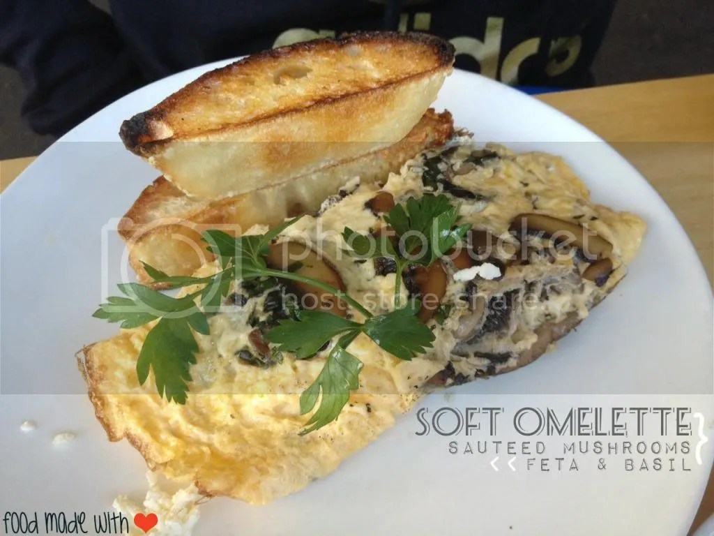 Soft omelette with mushrooms, feta and basil