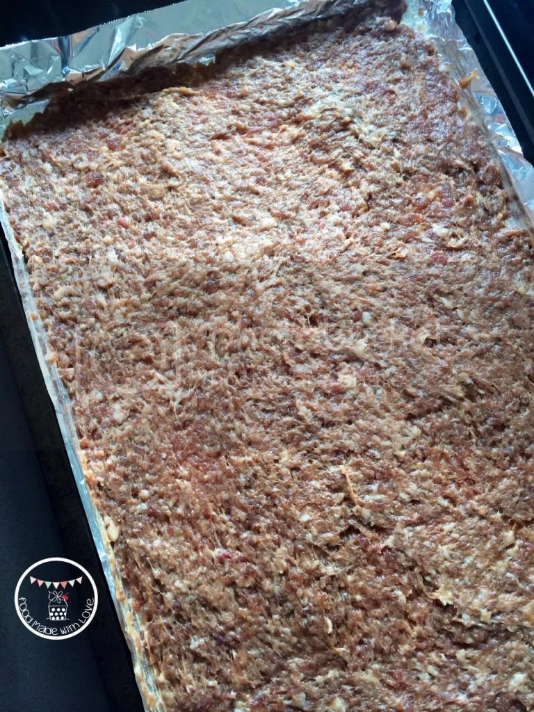pork mince mixture spread onto baking tray