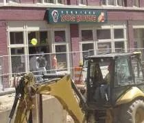 Construction equipment in front of the Downtown Dog House in downtown Lansing.