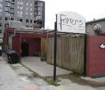 The entrance to Farrens Pub and Eatery in Champaign set back from the road.
