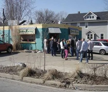 This is part of the line at 12:30 waiting to get in to the Golden Harvest for breakfast on a Sunday afternoon.