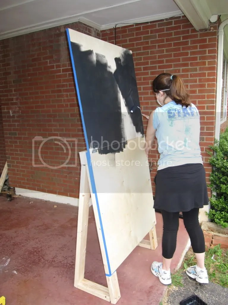 Heres me painting - first few painting strokes of the day. Forgive my garb - Beans and I were supposed to go running but it was real hot so we power walked, instead.