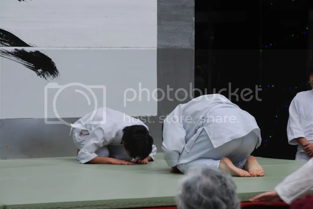 Aikido club exhibition - bowing to each other before they beat each other down