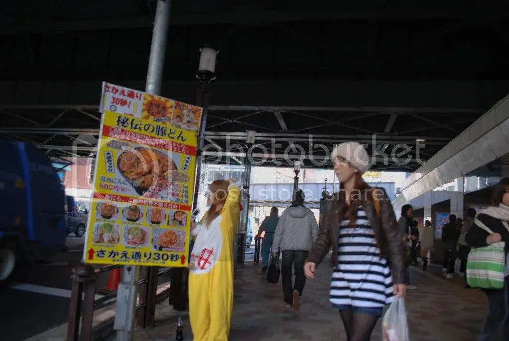 girl in a chicken suit advertises for a restaurant