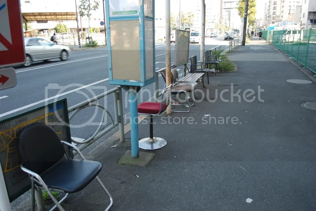 ghetto bus stop. random chairs instead of benches