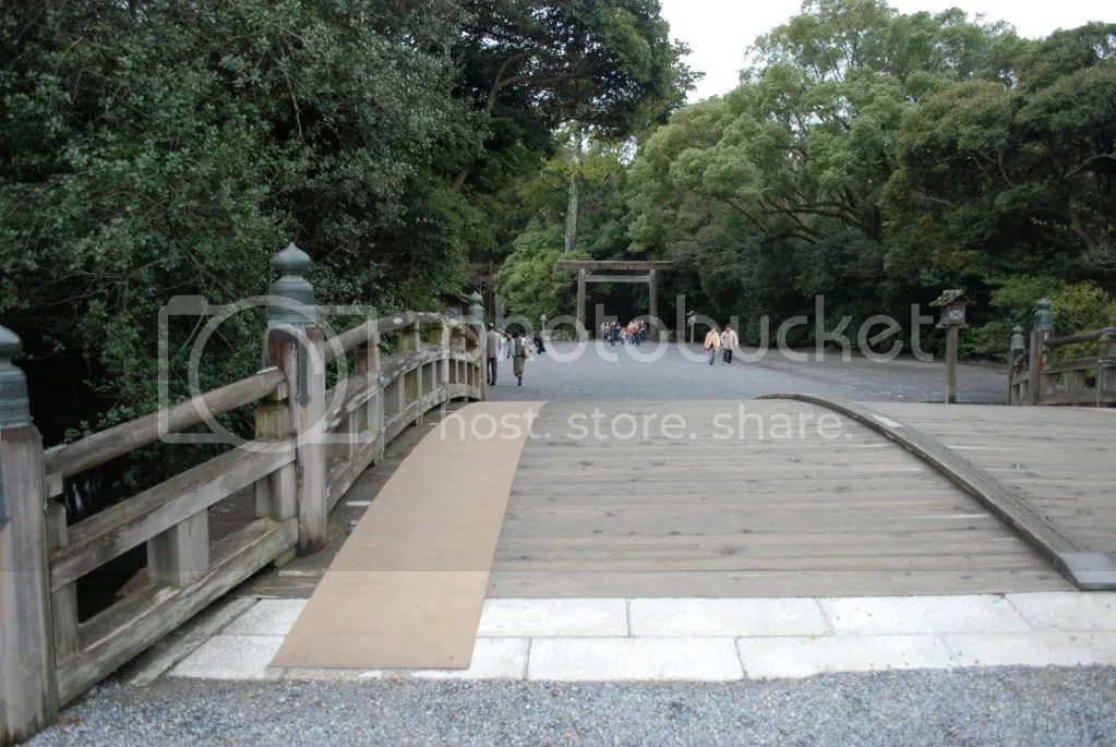 a bridge leading up to the outer shrine