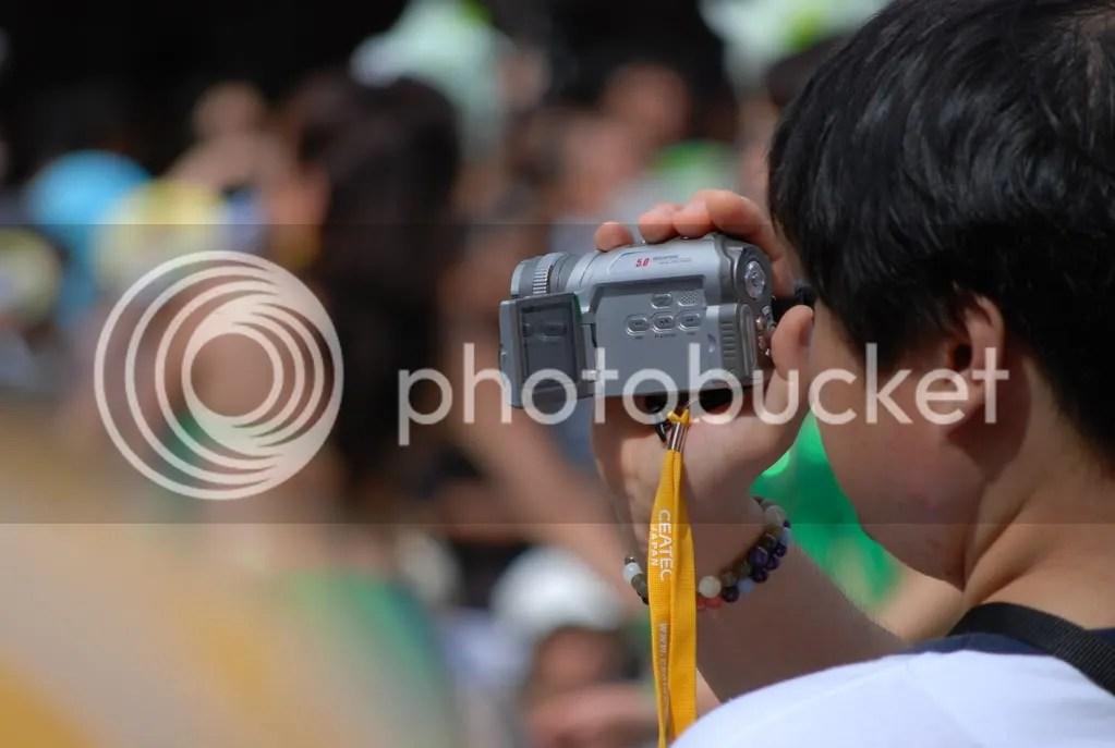 Man videotaping the parade