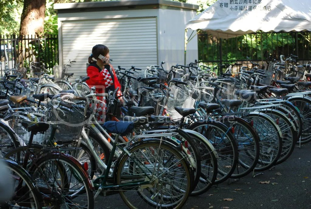 A festival volunteer looks over all the bikes parked on the edge of campus for the festival