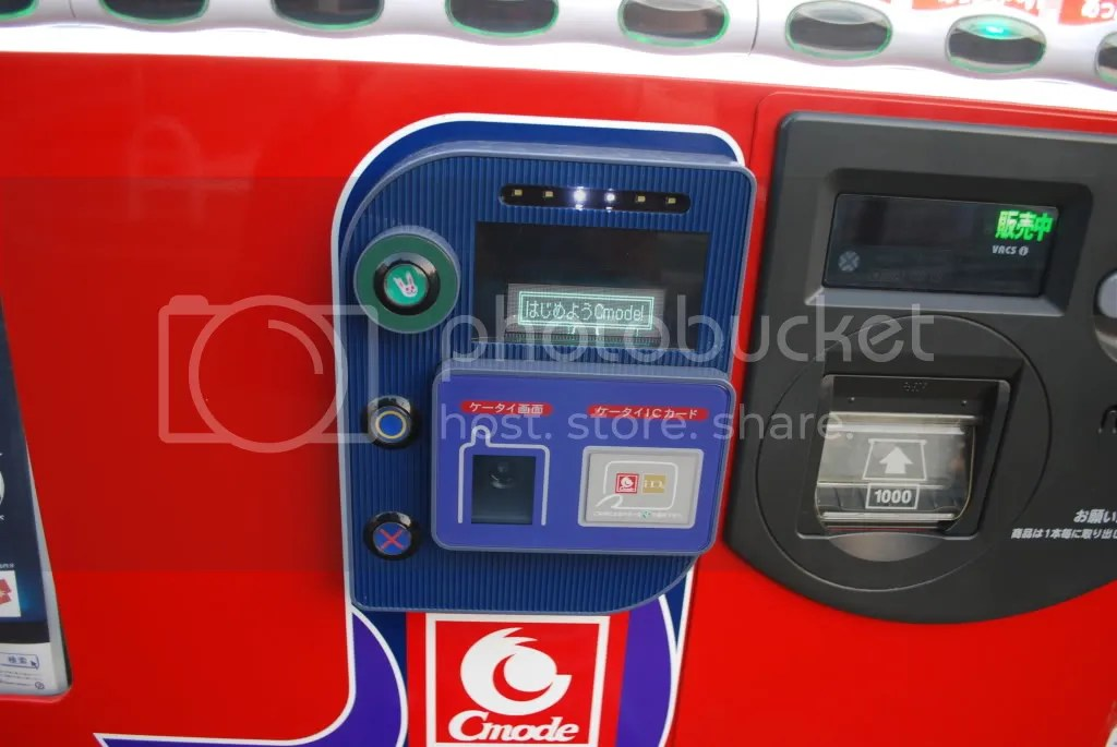 On this vending machine, you can pay with your cell phone. Most cell phones allow you to put money on an account attached to the phone (like a debit account). You can then use the money for the train, vending machines, and some stores.  You simply have to swipe the phone over a sensor and the money is automatically deducted.