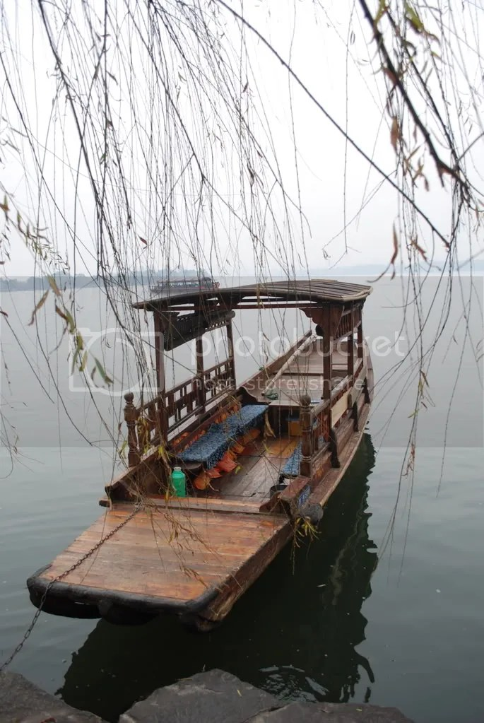 The boat we took with weeping willows in front of it