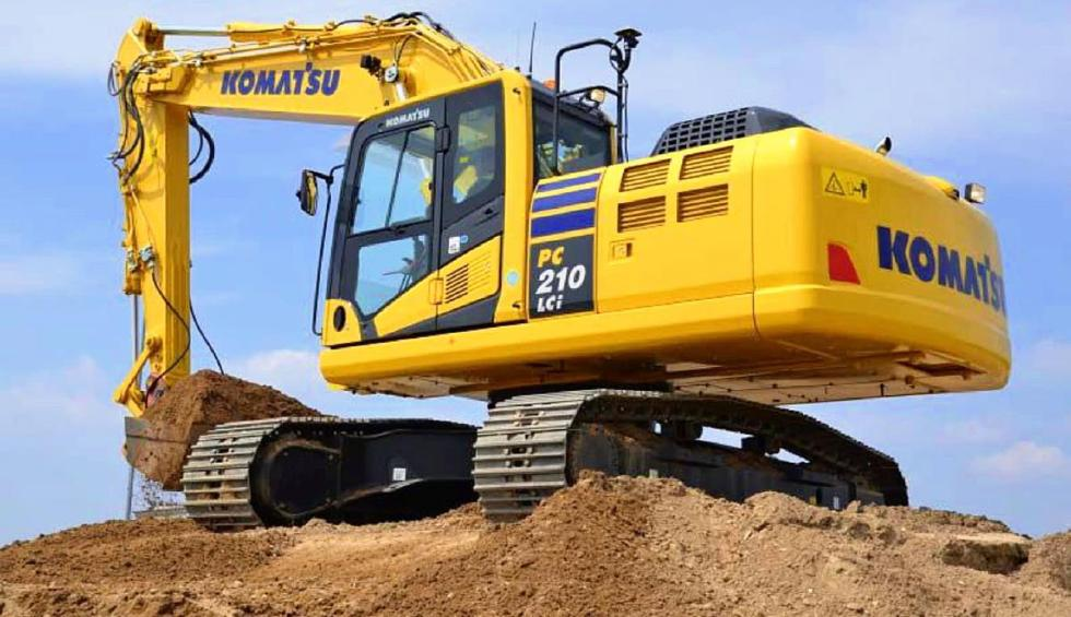 heavy equipment yellow komatsu on top of hill
