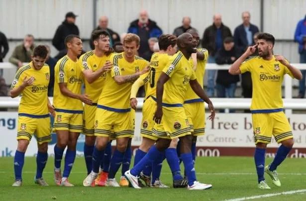 Wrexham celebrate Connor Jennings' goal against Woking