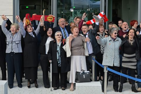 Hillsborough victims' families celebrate outside the coroner's court in Warrington today.