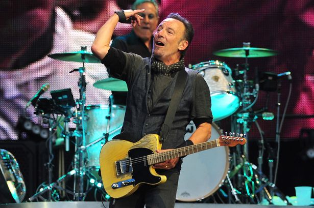 Bruce Springsteen performing at the Etihad