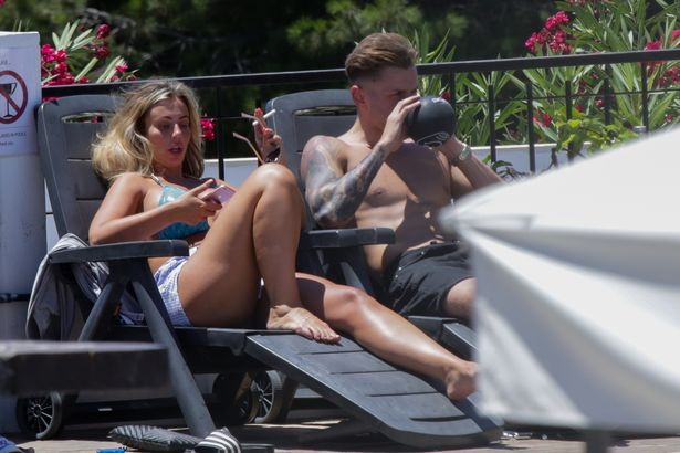 Holly was joined by her new boyfriend and pals (Image: Mega Agency)