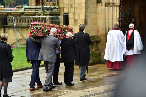 The family carries the coffin into the church