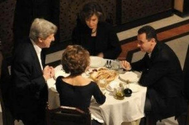 Secretery of State John Kerry sits down for a cosy dinner with the new Hitler President Assad