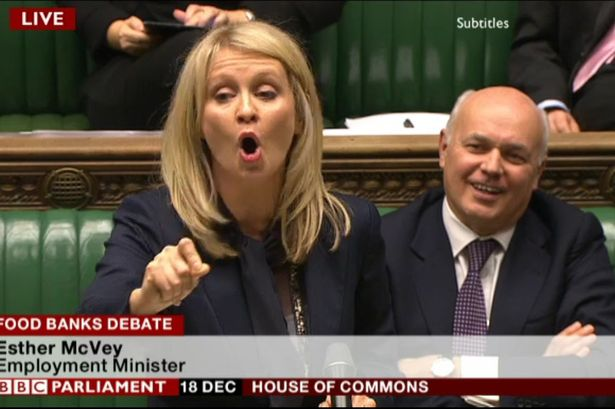 Ian Duncan Smith smirks as his deputy Esther McVey gives her speech