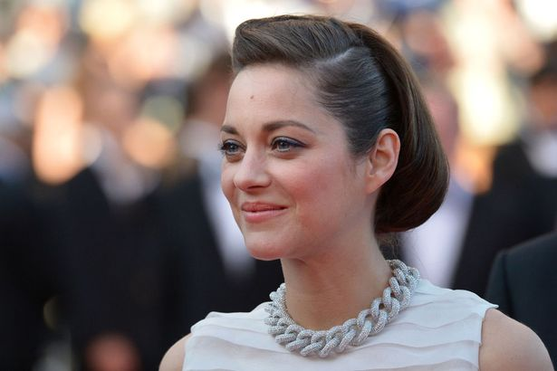 French actress Marion Cotillard smiles