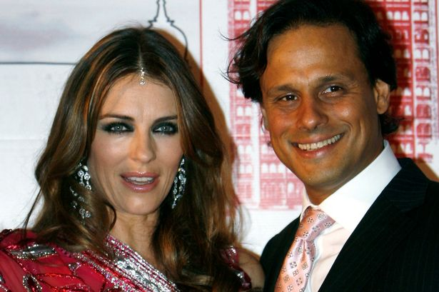 British actress Elizabeth Hurley poses with husband Arun Nayar