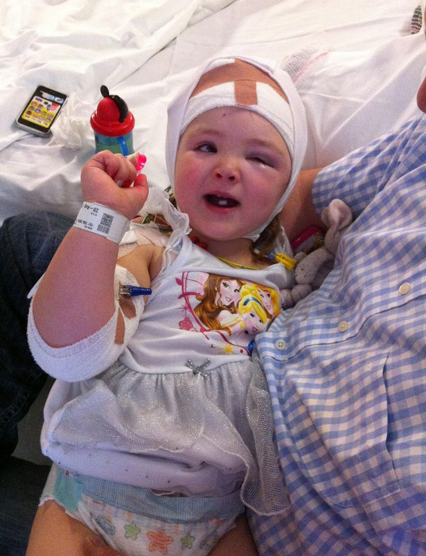 A brave schoolgirl has had two major brain operations after suffering more than 100 seizures a day. Little Seren Hughes