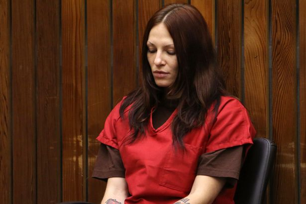 Alix Catherine Tichelman sits in the courtroom during her arraignment