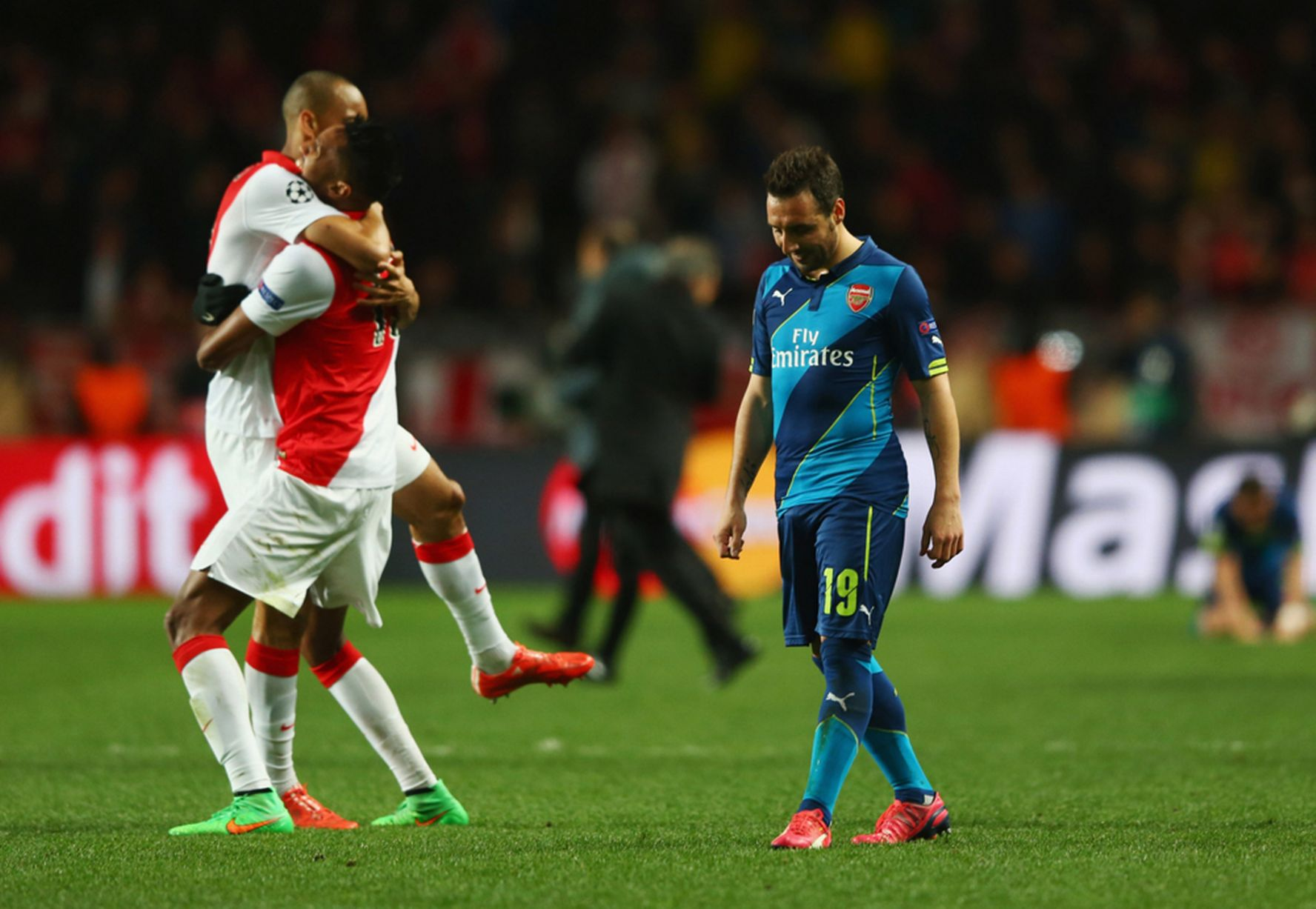Santi Cazorla looks dejected as Monaco players celebrate