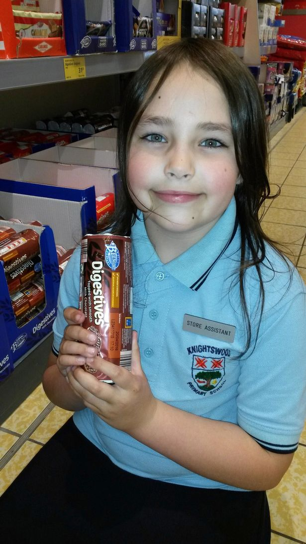 8-year-old Carina Brooks has landed a 'job' at Aldi and is being paid in fizzy sweets