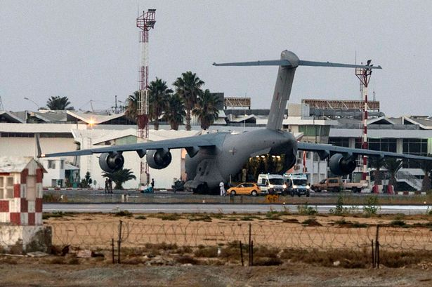 An RAF Hercules C17 military transport aircraft waits on the tarmac at the Habib Bourguiba International airport in Monastir, south of the Sousse, to transport British citizens injured in the deadly shooting attack