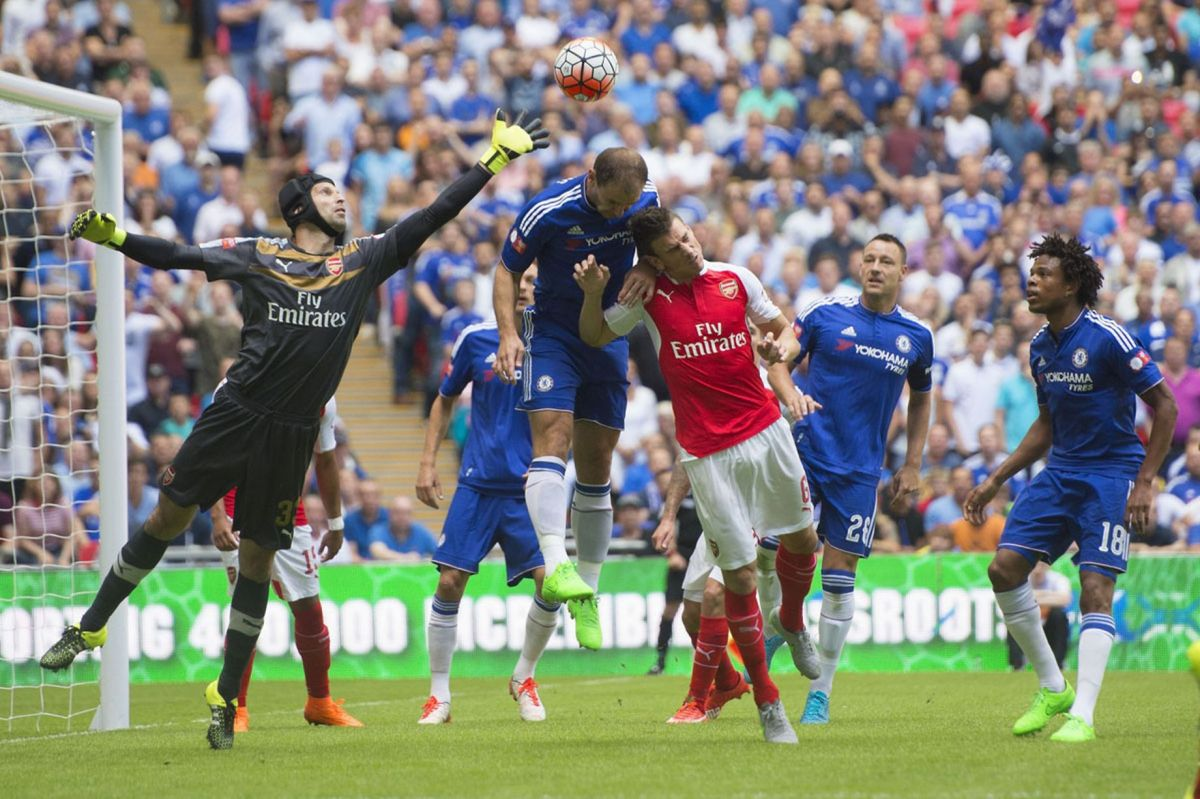 Petr Cech clears the ball from Branislav Ivanovic