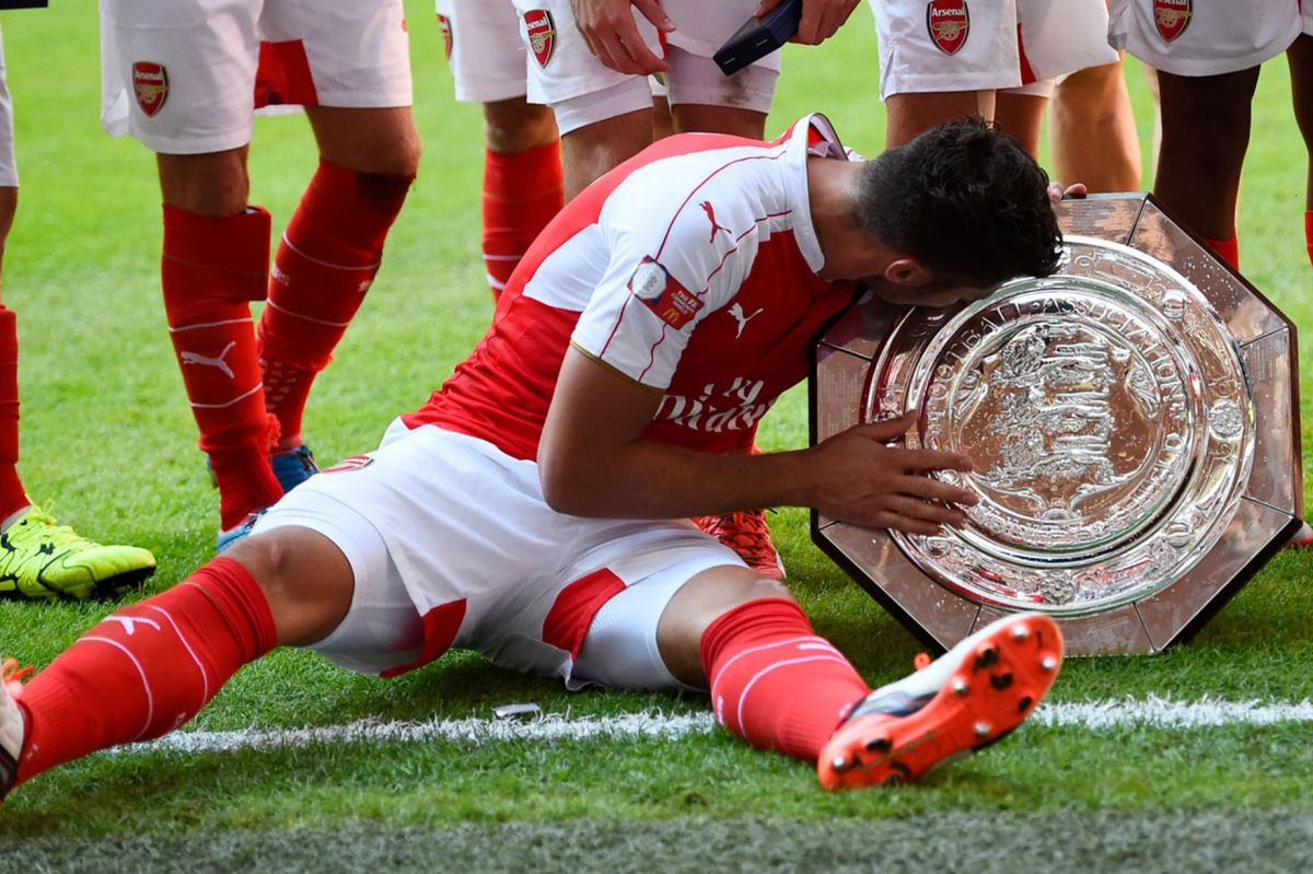 Olivier Giroud celebrates with the trophy